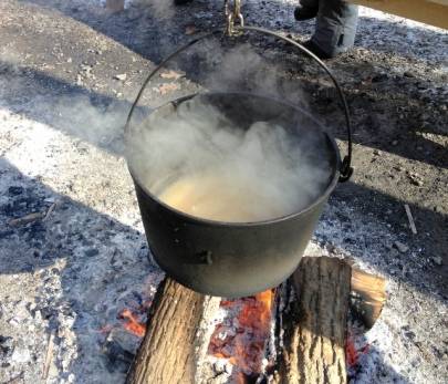 Boiling Syrup to Make Taffy on Snow